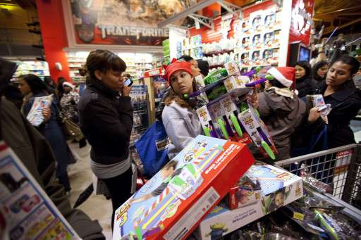 "NEW YORK - NOVEMBER 25: An employee (C) helps shoppers with Toy Story 3 toys at Toys""R""Us on Thanksgiving Day, November 25, 2010, in New York City. The stores, which opened nationwide at 10PM, will remain open for 24 hours for Black Friday.   Michael Nagle/Getty Images/AFP== FOR NEWSPAPERS, INTERNET, TELCOS & TELEVISION USE ONLY =="