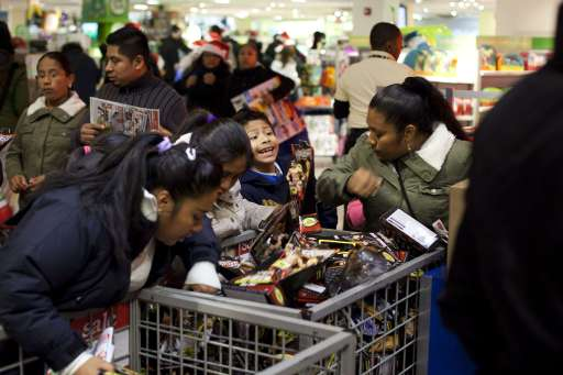 "NEW YORK - NOVEMBER 25: Shoppers look for bargains at Toys""R""Us on Thanksgiving Day, November 25, 2010, in New York City. The stores, which opened nationwide at 10PM, will remain open for 24 hours for Black Friday.   Michael Nagle/Getty Images/AFP== FOR NEWSPAPERS, INTERNET, TELCOS & TELEVISION USE ONLY =="