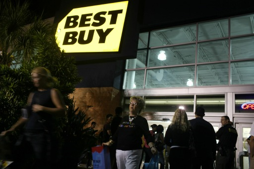 NAPLES, FL - NOVEMBER 26: Shoppers exit a Best Buy store at dawn during Black Friday, the day after Thanksgiving which commences the holiday gift-buying season on November 26, 2010 in Naples, Florida. Hundreds of shoppers spent the night camped in front of the store to be the first ones in when doors opened at 5am. Black Friday typically features steep discounts on such favorite items as toys and electronics.   Spencer Platt/Getty Images/AFP== FOR NEWSPAPERS, INTERNET, TELCOS & TELEVISION USE ONLY ==