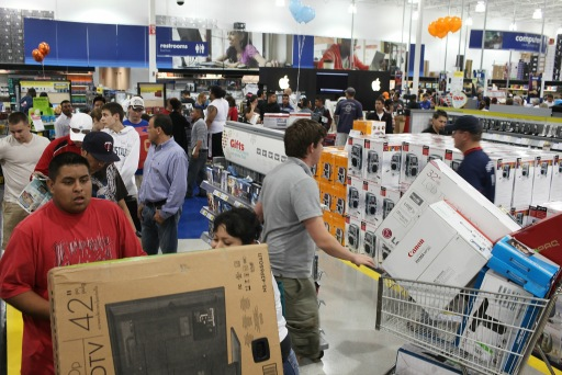 NAPLES, FL - NOVEMBER 26: Shoppers crowd a Best Buy store at dawn during Black Friday, the day after Thanksgiving which commences the holiday gift-buying season on November 26, 2010 in Naples, Florida. Hundreds of shoppers spent the night camped in front of the store to be the first ones in when doors opened at 5am. Black Friday typically features steep discounts on such favorite items as toys and electronics.   Spencer Platt/Getty Images/AFP== FOR NEWSPAPERS, INTERNET, TELCOS & TELEVISION USE ONLY ==