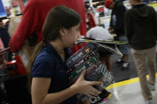 NAPLES, FL - NOVEMBER 26: Jennifer Fernandez, 10, shops with her parents after entering a Best Buy store at dawn during Black Friday, the day after Thanksgiving which commences the holiday gift-buying season on November 26, 2010 in Naples, Florida. Hundreds of shoppers spent the night camped in front of the store to be the first ones in when doors opened at 5am. Black Friday typically features steep discounts on such favorite items as toys and electronics.   Spencer Platt/Getty Images/AFP== FOR NEWSPAPERS, INTERNET, TELCOS & TELEVISION USE ONLY ==