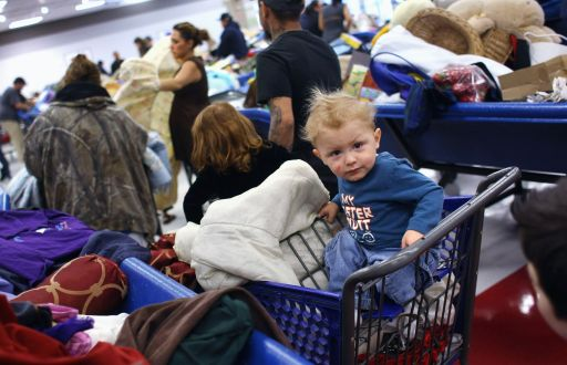 DENVER - NOVEMBER 26: Walter Holley, 18 months, waits as his mother Audrey Holley (2nd L), shops for linens at a Goodwill thrift store on Black Friday, November 26, 2010 in Denver, Colorado. People packed the thrift store on the busiest shopping day of the year, buying toys and clothes in bulk for as cheap as 59 cents a pound.   John Moore/Getty Images/AFP== FOR NEWSPAPERS, INTERNET, TELCOS & TELEVISION USE ONLY ==