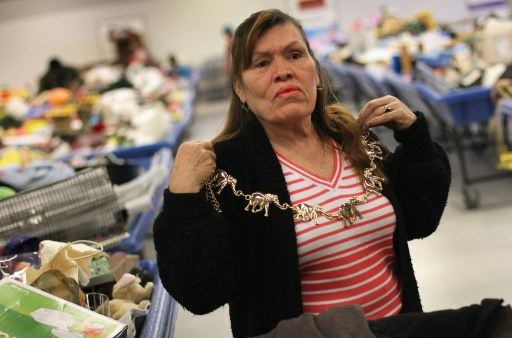 DENVER - NOVEMBER 26: Elma Escobedo tries on a second-hand necklace at a Goodwill thrift store on Black Friday, November 26, 2010 in Denver, Colorado. Low-income shoppers packed the thrift store on the busiest shopping day of the year, buying toys and clothes in bulk for as cheap as 59 cents a pound.   John Moore/Getty Images/AFP== FOR NEWSPAPERS, INTERNET, TELCOS & TELEVISION USE ONLY ==