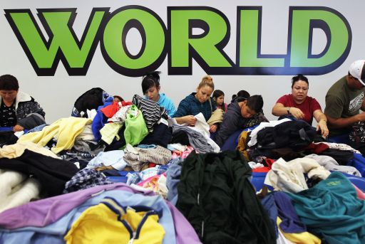 DENVER - NOVEMBER 26: Shoppers cull through bins of clothing at a Goodwill thrift store on Black Friday, November 26, 2010 in Denver, Colorado. Low-income shoppers packed the thrift store on the busiest shopping day of the year, buying toys and clothes in bulk for as cheap as 59 cents a pound.   John Moore/Getty Images/AFP== FOR NEWSPAPERS, INTERNET, TELCOS & TELEVISION USE ONLY ==