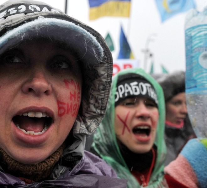 "A protester with ""We are not cattle"" written on her cheek, shouts slogans during a rally on Independence Square in Kiev on November 29, 2010. Thousands of Ukrainians have turned out in noisy demonstrations across the country against the reforms, in a nasty surprise for Yanukovych just as he seemed to be asserting his authority after taking power in February. Ukraine has not seen protests on this scale since the 2004 Orange Revolution popular uprising that ousted the old elite and installed Yanukovych's pro-Western predecessors in power.   AFP PHOTO / SERGEI SUPINSKY"