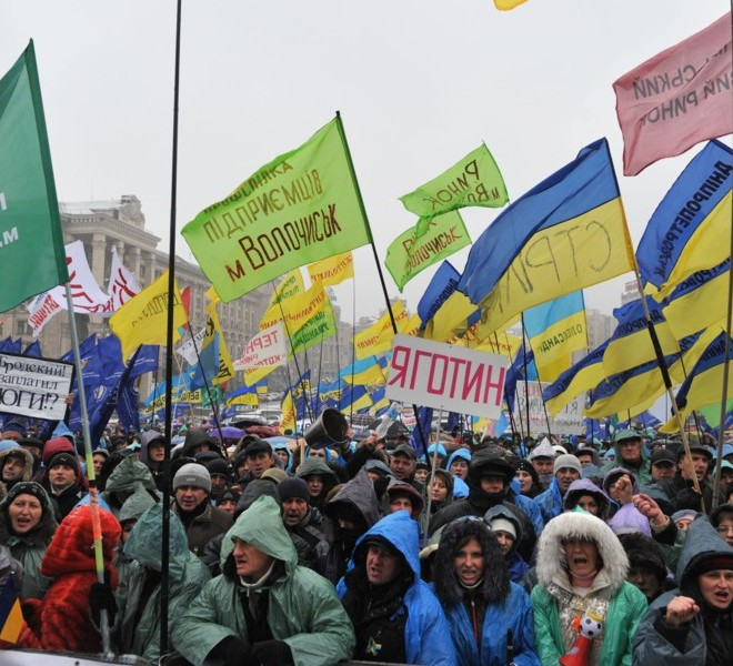 Protesters shout slogans during rally on Independence Square in Kiev on November 29, 2010. Thousands of Ukrainians have turned out in noisy demonstrations across the country against the taxes reforms, in a nasty surprise for President Viktor Yanukovych just as he seemed to be asserting his authority after taking power in February. Ukraine has not seen protests on this scale since the 2004 Orange Revolution popular uprising that ousted the old elite and installed Yanukovych's pro-Western predecessors in power. AFP PHOTO/ SERGEI SUPINSKY