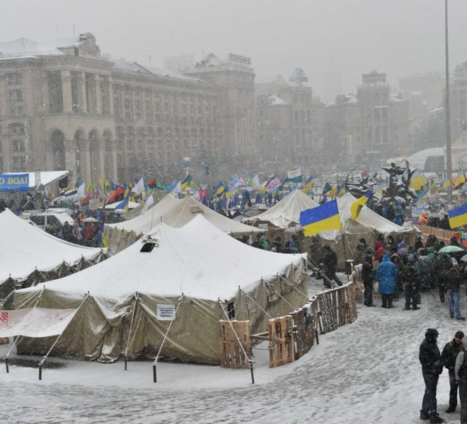 Protesters rally in front of a tent camp on Independence Square in Kiev on November 29, 2010. Thousands of Ukrainians have turned out in noisy demonstrations across the country against the taxes reforms, in a nasty surprise for President Viktor Yanukovych just as he seemed to be asserting his authority after taking power in February. Ukraine has not seen protests on this scale since the 2004 Orange Revolution popular uprising that ousted the old elite and installed Yanukovych's pro-Western predecessors in power. AFP PHOTO/ SERGEI SUPINSKY