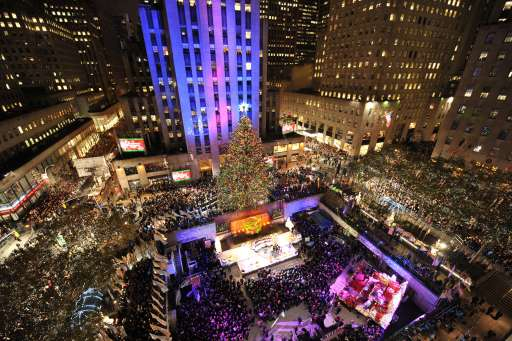 The Rockefeller Center Christmas Tree is lit on November 30, 2010 in New York. Originally from Mahopac, New York,. the 12-ton, 74-foot Norway Spruce is adorned with 30,000 environmentally friendly LED lights on more than five miles of electrical wire, and topped with a Swarovski crystal star.  AFP PHOTO / Stan Honda