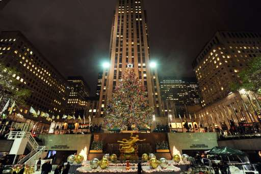 The Rockefeller Center Christmas Tree is lit on November 30, 2010 in New York. Originally from Mahopac, New York, the 12-ton, 74-foot Norway Spruce is adorned with 30,000 environmentally friendly LED lights on more than five miles of electrical wire, and topped with a Swarovski crystal star.  AFP PHOTO / Stan Honda