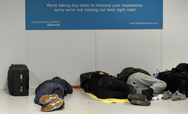 A passenger rests on the floor, after heavy snow closed the runway cancelling flights, at Gatwick Airport in southern England on December 01, 2010.  Britain's transport links with the rest of the world were disrupted by the early winter snowfall as key airports closed Wednesday and international Eurostar train services were cut.  London Gatwick Airport, Europe's eighth busiest passenger air hub, was closed until at least 6:00 am (0600 GMT) Thursday as staff worked on clearing the two runways.      TOPSHOTS/AFP PHOTO / CARL COURT , A gallery assistant uses a shovel to clear snow from the pavement on the High Street in Hartney Wintney, southern England on December 2, 2010.      Airports were shut, trains were stranded and roads were closed in Britain on Thursday amid a week-long freeze that has sparked questions about why the country grinds to a halt when snow falls.       AFP PHOTO / ADRIAN DENNIS , Hart District council workers shovel the snow from the pavement on the High Street in Hartney Wintney, southern England on December 2, 2010.      Airports were shut, trains were stranded and roads were closed in Britain on Thursday amid a week-long freeze that has sparked questions about why the country grinds to a halt when snow falls.       AFP PHOTO / ADRIAN DENNIS , A snow covered train stands at a platform opposite an empty platform at Tonbridge Train Station in Tonbridge, south-east England on December 2, 2010. Fresh snowfalls swept northern Europe once again Thursday, causing misery for travellers as airports remain closed, roads were blocked and Eurostar international rail services were cancelled.  The unseasonable cold snap, which has lasted nearly a week, has caused Britain to grind to a halt, with thousands of schools closed and commuters stranded as rail services were cancelled and icy roads deemed unsafe.    AFP PHOTO/IAN KINGTON , Workers clear the snow from the High Street in Tonbridge, south-east England on December 2, 2010. Fresh snowfalls swept northern Europe once again Thursday, causing misery for travellers as airports remain closed, roads were blocked and Eurostar international rail services were cancelled.  The unseasonable cold snap, which has lasted nearly a week, has caused Britain to grind to a halt, with thousands of schools closed and commuters stranded as rail services were cancelled and icy roads deemed unsafe.    AFP PHOTO/IAN KINGTON , Passengers queue at the Eurostar check-in desk at St Pancras International station in central London, on December 02, 2010.  Fresh snowfalls swept northern Europe once again Thursday, causing misery for travellers as airports remain closed, roads were blocked and Eurostar international rail services were cancelled.  The unseasonable cold snap, which has lasted nearly a week, has caused Britain to grind to a halt, with thousands of schools closed and commuters stranded as rail services were cancelled and icy roads deemed unsafe.      AFP PHOTO / CARL COURT , Passengers queue at the Eurostar check-in desk at St Pancras International station in central London, on December 02, 2010.  Fresh snowfalls swept northern Europe once again Thursday, causing misery for travellers as airports remain closed, roads were blocked and Eurostar international rail services were cancelled.  The unseasonable cold snap, which has lasted nearly a week, has caused Britain to grind to a halt, with thousands of schools closed and commuters stranded as rail services were cancelled and icy roads deemed unsafe.      AFP PHOTO / CARL COURT , Passengers queue at the Eurostar check-in desk at St Pancras International station in central London, on December 02, 2010.  Fresh snowfalls swept northern Europe once again Thursday, causing misery for travellers as airports remain closed, roads were blocked and Eurostar international rail services were cancelled.  The unseasonable cold snap, which has lasted nearly a week, has caused Britain to grind to a halt, with thousands of schools closed and commuters stranded as rail services were cancelled and icy roads deemed unsafe.      AFP PHOTO / CARL COURT , An EasyJet aeroplane prepares to land at a snow-covered Gatwick Airport in southern England on December 03, 2010.  Frustration grew in Britain on Friday as the cold snap snarled up transport links but the funny side of life in the snow was also showing through.  London Gatwick reopened after a two-day shutdown, but other airports and rail services were out of action.     AFP PHOTO / CARL COURT , A Thomson aeroplane lands at a snow-covered Gatwick Airport in southern England on December 03, 2010.  Frustration grew in Britain on Friday as the cold snap snarled up transport links but the funny side of life in the snow was also showing through.  London Gatwick reopened after a two-day shutdown, but other airports and rail services were out of action.     AFP PHOTO / CARL COURT , An EasyJet aeroplane prepares to land at a snow-covered Gatwick Airport in southern England on December 03, 2010.  Frustration grew in Britain on Friday as the cold snap snarled up transport links but the funny side of life in the snow was also showing through.  London Gatwick reopened after a two-day shutdown, but other airports and rail services were out of action.     AFP PHOTO / CARL COURT , Passengers queue at check-in desk after flights commenced agains at Gatwick Airport in southern England on December 03, 2010.  Frustration grew in Britain on Friday as the cold snap snarled up transport links but the funny side of life in the snow was also showing through.  London Gatwick reopened after a two-day shutdown, but other airports and rail services were out of action.     AFP PHOTO / CARL COURT , Passengers queue at check-in desks after flights commenced again at Gatwick Airport in southern England on December 03, 2010.  Frustration grew in Britain on Friday as the cold snap snarled up transport links but the funny side of life in the snow was also showing through.  London Gatwick reopened after a two-day shutdown, but other airports and rail services were out of action.     AFP PHOTO / CARL COURT , A Viking aeroplane taxis to the snow-cleared runway at Gatwick Airport in southern England on December 03, 2010.  Frustration grew in Britain on Friday as the cold snap snarled up transport links but the funny side of life in the snow was also showing through.  London Gatwick reopened after a two-day shutdown, but other airports and rail services were out of action.     AFP PHOTO / CARL COURT , A man rests on the floor next to a check-in desk, after heavy snow closed the runway at Gatwick Airport in southern England on December 01, 2010.  Britain's transport links with the rest of the world were disrupted by the early winter snowfall as key airports closed Wednesday and international Eurostar train services were cut.  London Gatwick Airport, Europe's eighth busiest passenger air hub, was closed until at least 6:00 am (0600 GMT) Thursday as staff worked on clearing the two runways.      AFP PHOTO / CARL COURT , A person rests on the floor after heavy snow closed the runway delaying flights, at Gatwick Airport in southern England on December 01, 2010.  Britain's transport links with the rest of the world were disrupted by the early winter snowfall as key airports closed Wednesday and international Eurostar train services were cut.  London Gatwick Airport, Europe's eighth busiest passenger air hub, was closed until at least 6:00 am (0600 GMT) Thursday as staff worked on clearing the two runways.      AFP PHOTO / CARL COURT , People rest on the floor after heavy snow closed the runway cancelling flights, at Gatwick Airport in southern England on December 01, 2010.  Britain's transport links with the rest of the world were disrupted by the early winter snowfall as key airports closed Wednesday and international Eurostar train services were cut.  London Gatwick Airport, Europe's eighth busiest passenger air hub, was closed until at least 6:00 am (0600 GMT) Thursday as staff worked on clearing the two runways.      AFP PHOTO / CARL COURT