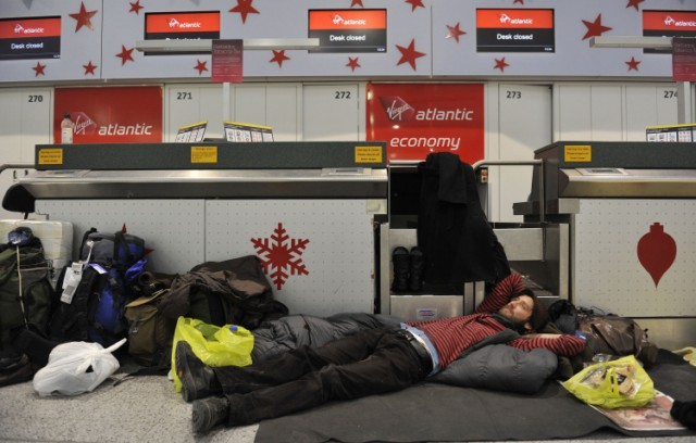 A passenger rests on the floor, after heavy snow closed the runway cancelling flights, at Gatwick Airport in southern England on December 01, 2010.  Britain's transport links with the rest of the world were disrupted by the early winter snowfall as key airports closed Wednesday and international Eurostar train services were cut.  London Gatwick Airport, Europe's eighth busiest passenger air hub, was closed until at least 6:00 am (0600 GMT) Thursday as staff worked on clearing the two runways.      TOPSHOTS/AFP PHOTO / CARL COURT , A gallery assistant uses a shovel to clear snow from the pavement on the High Street in Hartney Wintney, southern England on December 2, 2010.      Airports were shut, trains were stranded and roads were closed in Britain on Thursday amid a week-long freeze that has sparked questions about why the country grinds to a halt when snow falls.       AFP PHOTO / ADRIAN DENNIS , Hart District council workers shovel the snow from the pavement on the High Street in Hartney Wintney, southern England on December 2, 2010.      Airports were shut, trains were stranded and roads were closed in Britain on Thursday amid a week-long freeze that has sparked questions about why the country grinds to a halt when snow falls.       AFP PHOTO / ADRIAN DENNIS , A snow covered train stands at a platform opposite an empty platform at Tonbridge Train Station in Tonbridge, south-east England on December 2, 2010. Fresh snowfalls swept northern Europe once again Thursday, causing misery for travellers as airports remain closed, roads were blocked and Eurostar international rail services were cancelled.  The unseasonable cold snap, which has lasted nearly a week, has caused Britain to grind to a halt, with thousands of schools closed and commuters stranded as rail services were cancelled and icy roads deemed unsafe.    AFP PHOTO/IAN KINGTON , Workers clear the snow from the High Street in Tonbridge, south-east England on December 2, 2010. Fresh snowfalls swept northern Europe once again Thursday, causing misery for travellers as airports remain closed, roads were blocked and Eurostar international rail services were cancelled.  The unseasonable cold snap, which has lasted nearly a week, has caused Britain to grind to a halt, with thousands of schools closed and commuters stranded as rail services were cancelled and icy roads deemed unsafe.    AFP PHOTO/IAN KINGTON , Passengers queue at the Eurostar check-in desk at St Pancras International station in central London, on December 02, 2010.  Fresh snowfalls swept northern Europe once again Thursday, causing misery for travellers as airports remain closed, roads were blocked and Eurostar international rail services were cancelled.  The unseasonable cold snap, which has lasted nearly a week, has caused Britain to grind to a halt, with thousands of schools closed and commuters stranded as rail services were cancelled and icy roads deemed unsafe.      AFP PHOTO / CARL COURT , Passengers queue at the Eurostar check-in desk at St Pancras International station in central London, on December 02, 2010.  Fresh snowfalls swept northern Europe once again Thursday, causing misery for travellers as airports remain closed, roads were blocked and Eurostar international rail services were cancelled.  The unseasonable cold snap, which has lasted nearly a week, has caused Britain to grind to a halt, with thousands of schools closed and commuters stranded as rail services were cancelled and icy roads deemed unsafe.      AFP PHOTO / CARL COURT , Passengers queue at the Eurostar check-in desk at St Pancras International station in central London, on December 02, 2010.  Fresh snowfalls swept northern Europe once again Thursday, causing misery for travellers as airports remain closed, roads were blocked and Eurostar international rail services were cancelled.  The unseasonable cold snap, which has lasted nearly a week, has caused Britain to grind to a halt, with thousands of schools closed and commuters stranded as rail services were cancelled and icy roads deemed unsafe.      AFP PHOTO / CARL COURT , An EasyJet aeroplane prepares to land at a snow-covered Gatwick Airport in southern England on December 03, 2010.  Frustration grew in Britain on Friday as the cold snap snarled up transport links but the funny side of life in the snow was also showing through.  London Gatwick reopened after a two-day shutdown, but other airports and rail services were out of action.     AFP PHOTO / CARL COURT , A Thomson aeroplane lands at a snow-covered Gatwick Airport in southern England on December 03, 2010.  Frustration grew in Britain on Friday as the cold snap snarled up transport links but the funny side of life in the snow was also showing through.  London Gatwick reopened after a two-day shutdown, but other airports and rail services were out of action.     AFP PHOTO / CARL COURT , An EasyJet aeroplane prepares to land at a snow-covered Gatwick Airport in southern England on December 03, 2010.  Frustration grew in Britain on Friday as the cold snap snarled up transport links but the funny side of life in the snow was also showing through.  London Gatwick reopened after a two-day shutdown, but other airports and rail services were out of action.     AFP PHOTO / CARL COURT , Passengers queue at check-in desk after flights commenced agains at Gatwick Airport in southern England on December 03, 2010.  Frustration grew in Britain on Friday as the cold snap snarled up transport links but the funny side of life in the snow was also showing through.  London Gatwick reopened after a two-day shutdown, but other airports and rail services were out of action.     AFP PHOTO / CARL COURT , Passengers queue at check-in desks after flights commenced again at Gatwick Airport in southern England on December 03, 2010.  Frustration grew in Britain on Friday as the cold snap snarled up transport links but the funny side of life in the snow was also showing through.  London Gatwick reopened after a two-day shutdown, but other airports and rail services were out of action.     AFP PHOTO / CARL COURT , A Viking aeroplane taxis to the snow-cleared runway at Gatwick Airport in southern England on December 03, 2010.  Frustration grew in Britain on Friday as the cold snap snarled up transport links but the funny side of life in the snow was also showing through.  London Gatwick reopened after a two-day shutdown, but other airports and rail services were out of action.     AFP PHOTO / CARL COURT , A man rests on the floor next to a check-in desk, after heavy snow closed the runway at Gatwick Airport in southern England on December 01, 2010.  Britain's transport links with the rest of the world were disrupted by the early winter snowfall as key airports closed Wednesday and international Eurostar train services were cut.  London Gatwick Airport, Europe's eighth busiest passenger air hub, was closed until at least 6:00 am (0600 GMT) Thursday as staff worked on clearing the two runways.      AFP PHOTO / CARL COURT