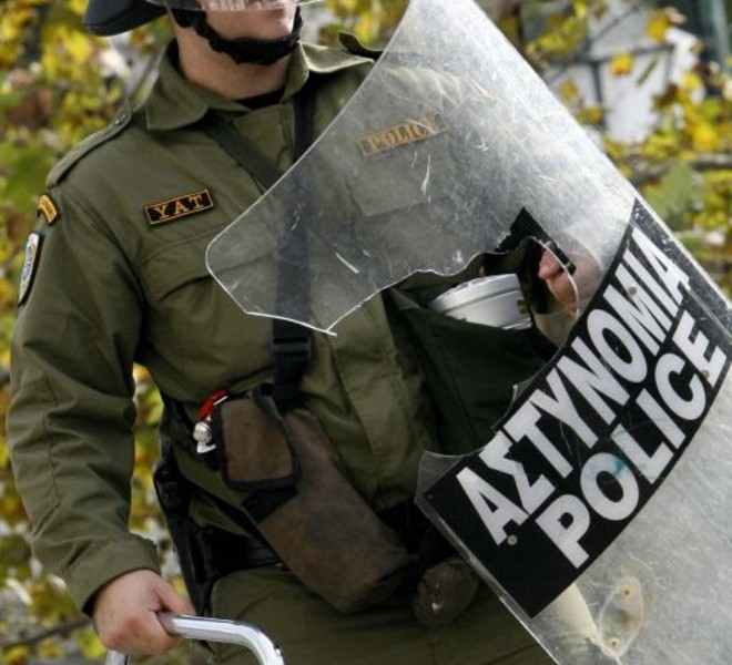 A riot policeman holds his destroyed shield during a demonstration in central Athens on December 6, 2010. Groups of hooded students hurled stones and blocks of wood at windows of banks and shops in the centre of the Greek capital as they marched towards the parliament building to mark the 2nd year anniversary of the death of teenager Alexis Grigoropoulos who was shot dead by police.     AFP PHOTO / Angelos Tzortzinis
