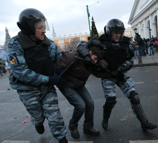 A Football fan is arrested by policemen following clashes with riot police in central Moscow on December 11, 2010,  after Yegor Sviridov, 28, a dedicated fan of the Spartak Moscow football team  was shot dead on December 4, 2010. Witnesses said Sviridov was shot in the head  in a mass fight with men from the Russian Caucasus. Another Spartak fan was shot in the stomach, the Kommersant daily reported. The incident exposed the close relationship between football fans and nationalist groups.AFP PHOTO/ ALEXEY SAZONOV