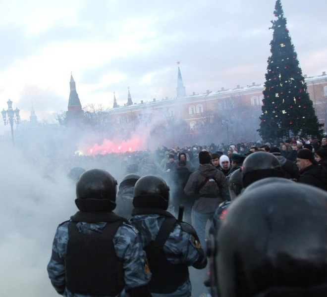 Football fans clash with riot police in central Moscow on December 11, 2010, after Yegor Sviridov, 28, a dedicated fan of the Spartak Moscow football team was shot dead on December 4, 2010. Witnesses said Sviridov was shot in the head in a mass fight with men from the Russian Caucasus. Another Spartak fan was shot in the stomach, the Kommersant daily reported. The incident exposed the close relationship between football fans and nationalist groups.AFP PHOTO/ ANDREY SMIRNOV