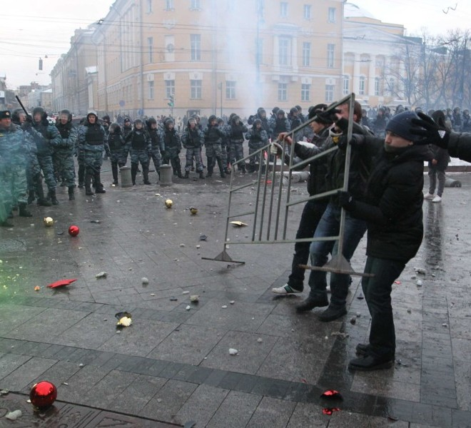 Football fans clash with riot police in central Moscow on December 11, 2010,  after Yegor Sviridov, 28, a dedicated fan of the Spartak Moscow football team  was shot dead on December 4, 2010. Witnesses said Sviridov was shot in the head  in a mass fight with men from the Russian Caucasus. Another Spartak fan was shot in the stomach, the Kommersant daily reported. The incident exposed the close relationship between football fans and nationalist groups.AFP PHOTO/ ALEXEY SAZONOV
