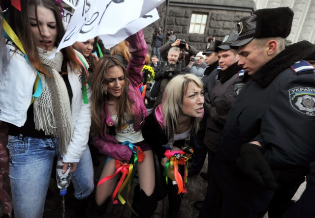 "Activists of the Ukrainian women's movement FEMEN activist hold placards, reading: ""Azarov is a liar, "" in reference to Prime Minister Mykola Azarov, "" To urinate standing is not privilege,"" ""Women at the Cabinet of Ministers,"" in front of the Cabinet Ministers building in Kiev on December 13, 2010 during an action, called ""The Cabinet is a men's  room"". The activists protested against the absence of women ministers in the newly reorganized government of  Azarov.                   AFP PHOTO / SERGEI SUPINSKY , Ukrainian feminist movement FEMEN activists pretend to urinate in front of Ukraine's Cabinet Ministers building in Kiev on December 13, 2010 during an action called ""The Cabinet is a men's  room"".  The activists protest against the lack of women in Prime Minister Mykola Azarov's newly reorganized government.    AFP PHOTO / SERGEI SUPINSKY , Ukrainian feminist movement FEMEN activists pretend to urinate in front of Ukraine's Cabinet Ministers building in Kiev on December 13, 2010 during an action called ""The Cabinet is a men's  room"".  The activists protest against the lack of women in Prime Minister Mykola Azarov's newly reorganized government.    AFP PHOTO / SERGEI SUPINSKY"