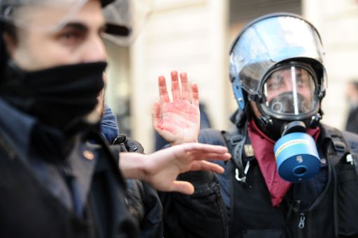 A demonstrator (C) is being arrested during a protest to demand a change of government as parliament met to hold a crucial vote that could topple Prime Minister Silvio Berlusconi on December 14, 2010 in Via del Corso in Rome. Italian Prime Minister Silvio Berlusconi scraped through a crucial confidence vote in the lower house of parliament by 314 votes in favour and 311 against. AFP PHOTO / VINCENZO PINTO