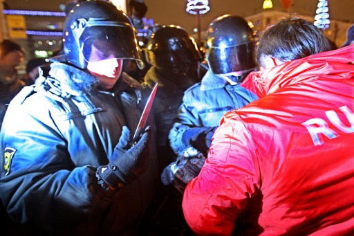 Russian riot police officer holds a knife recovered as they detain a protestor in central St. Petersburg on December 15, 2010 during a demonstration for Yegor Sviridov, 28, a dedicated fan of the Spartak Moscow football team shot dead on December 4, 2010. In Russia's second city of Saint Petersburg organised members of the far right descended on a major square that stands in the heart of the city amid modern shops and busy metro stations. The police there reported making more than 60 arrests. AFP PHOTO / KIRILL KUDRYAVTSEV