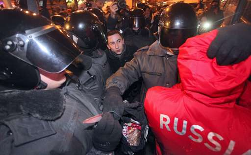 Russian riot police  hold a knife  discovered as they detain a protestor in central St. Petersburg on December 15, 2010 during a demonstration for Yegor Sviridov, 28, a dedicated fan of the Spartak Moscow football team shot dead on December 4, 2010. In Russia's second city of Saint Petersburg organised members of the far right descended on a major square that stands in the heart of the city amid modern shops and busy metro stations. The police there reported making more than 60 arrests. AFP PHOTO / INTERPRESS / MAXIM ZMEYEV