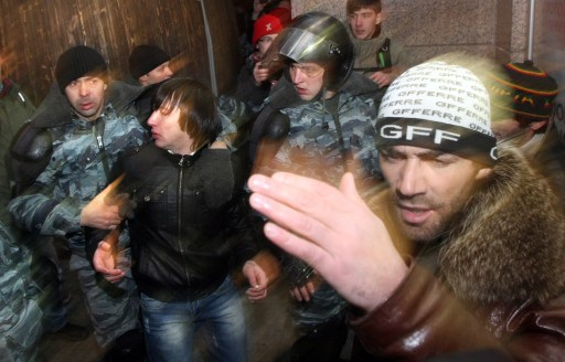 Russian riot police officers detain a protestor in central Moscow on December 15, 2010 during a demonstration for Yegor Sviridov, 28, a dedicated fan of the Spartak Moscow football team shot dead on December 4, 2010. Moscow police arrested more than 700 people Wednesday across the city centre in a bid to prevent ethnic clashes from erupting following the deadly shooting of a football fan, a spokesman said. AFP PHOTO/ ANDREY SMIRNOV