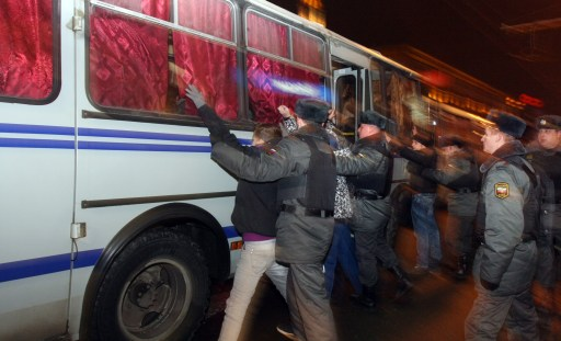 Russian riot police officers detain protestors in central Moscow on December 15, 2010 during a demonstration for Yegor Sviridov, 28, a dedicated fan of the Spartak Moscow football team shot dead on December 4, 2010. Moscow police arrested more than 700 people Wednesday across the city centre in a bid to prevent ethnic clashes from erupting following the deadly shooting of a football fan, a spokesman said. AFP PHOTO / ANDREY SMIRNOV