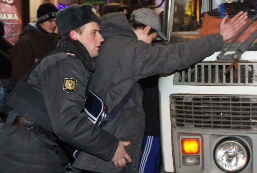Russian police officers detain a protestor in central Moscow on December 15, 2010 during a demonstration for Yegor Sviridov, 28, a dedicated fan of the Spartak Moscow football team shot dead on December 4, 2010. Moscow police arrested more than 700 people Wednesday across the city centre in a bid to prevent ethnic clashes from erupting following the deadly shooting of a football fan, a spokesman said. AFP PHOTO / ANDREY SMIRNOV
