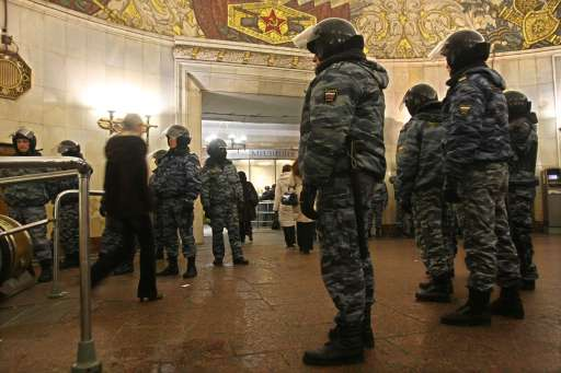 Russian riot police officers patrol the entrance of Smolenskaya metro station in central Moscow on December 15, 2010 during a demonstration for Yegor Sviridov, 28, a dedicated fan of the Spartak Moscow football team shot dead on December 4, 2010. Moscow police arrested more than 700 people Wednesday across the city centre in a bid to prevent ethnic clashes from erupting following the deadly shooting of a football fan, a spokesman said. AFP PHOTO / ANDREY SMIRNOV