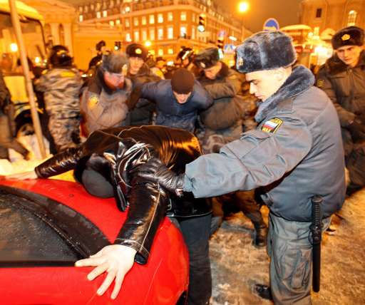 Russian riot police officers detain a protestor in central St. Petersburg on December 15, 2010 during a demonstration for Yegor Sviridov, 28, a dedicated fan of the Spartak Moscow football team shot dead on December 4, 2010. In Russia's second city of Saint Petersburg organised members of the far right descended on a major square that stands in the heart of the city amid modern shops and busy metro stations. The police there reported making more than 60 arrests. AFP PHOTO / KIRILL KUDRYAVTSEV