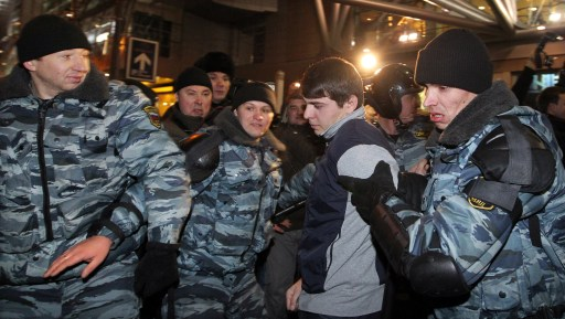 Russian riot police officers detain a protestor in central Moscow on December 15, 2010 during a demonstration for Yegor Sviridov, 28, a dedicated fan of the Spartak Moscow football team shot dead on December 4, 2010. Moscow police arrested more than 700 people Wednesday across the city centre in a bid to prevent ethnic clashes from erupting following the deadly shooting of a football fan, a spokesman said. AFP PHOTO/ ALEXEY SAZONOV