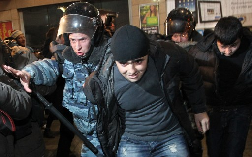 Russian riot police detain a man at the Kievsky train station in Moscow on December 15, 2010. Moscow police arrested more than 700 people Wednesday across the city centre in a bid to prevent ethnic clashes from erupting following the deadly shooting of a football fan, a spokesman said. AFP PHOTO / ALEXEY SAZONOV