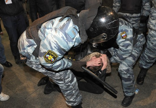 Russian riot police detain a man in central in Moscow on December 15, 2010. Moscow police arrested more than 700 people Wednesday across the city centre in a bid to prevent ethnic clashes from erupting following the deadly shooting of a football fan, a spokesman said.   AFP PHOTO/ ALEXANDER NEMENOV