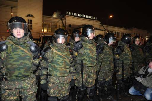 Russian riot police secure an area in central Moscow on December 15, 2010 during a demonstration for Yegor Sviridov, 28, a dedicated fan of the Spartak Moscow football team shot dead on December 4, 2010. Moscow police arrested more than 700 people Wednesday across the city centre in a bid to prevent ethnic clashes from erupting following the deadly shooting of a football fan, a spokesman said.   AFP PHOTO/ ALEXANDER NEMENOV