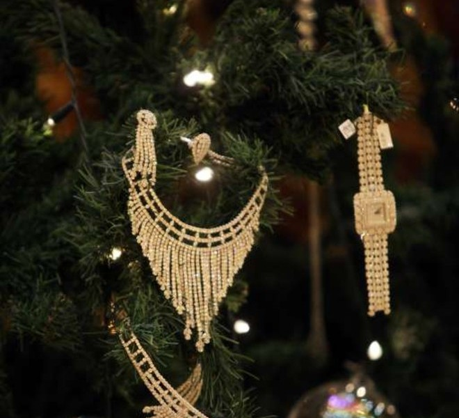 Jewellery decorates an 11-million-dollar Christmas tree at the Emirates Palace hotel in the Emirati capital Abu Dhabi on December 15, 2010. Christmas came in extravagant fashion to the Muslim desert emirate of Abu Dhabi as a glitzy hotel unveiled a bejewelled Christmas tree valued at more than 11 million dollars. AFP PHOTO/STR