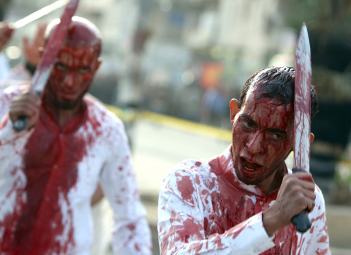 An Iraqi Shiite Muslim man bleeds as he takes part in a ritual in the capital Baghdad on December 16, 2010, during the Ashura commemorations marking the 7th century killing of Imam Hussein, the grandson of Prophet Mohammed, in the Battle of Karbala in central Iraq. AFP PHOTO/AHMAD AL-RUBAYE