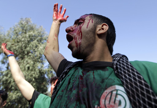 A Lebanese Shiite Muslim man and supporter of Amal movement beats himself in southern Beirut on December 16, 2010 as he takes part in Ashura commemorations marking the 7th century killing of Imam Hussein, the grandson of Prophet Mohammed, in the Battle of Karbala. AFP PHOTO/JOSEPH EID