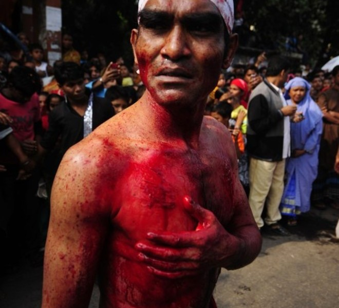 A Bangladeshi Shiite Muslim looks on as he takes part in a self-flagellation ritual during a religious procession of the Ashura mourning period in Dhaka on December 17, 2010. The religious festival of Ashura, which includes a ten-day mourning period starting on the first day of Muharram on the Islamic calendar, commemorates the seventh-century slaying of Prophet Mohammed's grandson Imam Hussein in Karbala. AFP Photo/Munir uz ZAMAN