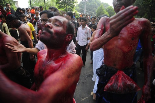 Bangladeshi Shiite Muslims take part in a self-flagellation ritual during a religious procession of the Ashura mourning period in Dhaka on December 17, 2010. The religious festival of Ashura, which includes a ten-day mourning period starting on the first day of Muharram on the Islamic calendar, commemorates the seventh-century slaying of Prophet Mohammed's grandson Imam Hussein in Karbala. AFP Photo/Munir uz ZAMAN