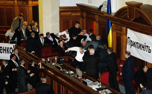 Ukrainian parliament deputies of pro-president Viktor Yanukovych majority  attack the opposition deputies  during the siession in Kiev on December 16, 2010. The deputies of the opposition blocked work of the parliament as they protest against criminal investigation began against their leader the former Prime Minister Yulia Tymoshenko. AFP PHOTO/SERGEY SVETLITSKY