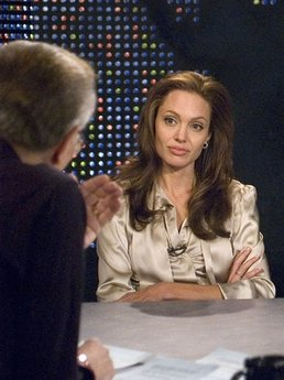 "FILE - In this Dec. 11, 2006 file photo provided by CNN, CNN's Larry King, left, interviews actress Angelina Jolie as she promotes the movie ""The Good Shepherd"" during a taping of Larry King Live in New York.  After 25 years of ""Larry King Live,"" Larry King will hang up his suspenders with his last broadcast on Thursday, Dec. 16, 2010. (AP Photo/CNN, Lorenzo Bevilaqua)"