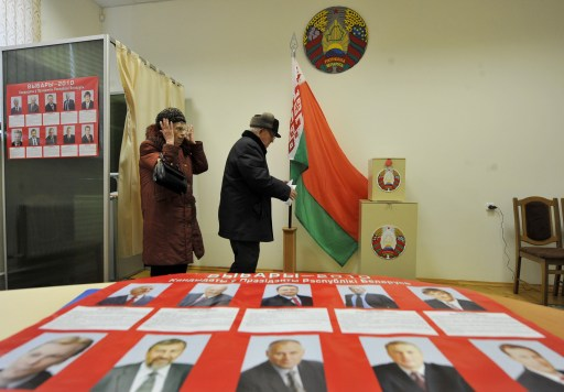 Belarus people leave polling-boothes before casting their ballots for the presidential elections early voting at a polling station in Minsk on December 17, 2010.  Presidential candidates in Belarus made a final push for votes Friday two days ahead of elections, with few doubting the dominance of incumbent strongman Alexander Lukashenko after a low-key campaign. / AFP PHOTO / VIKTOR DRACHEV