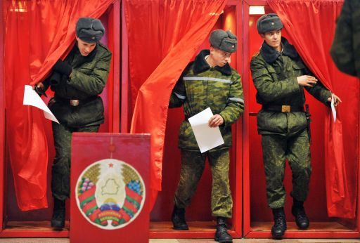 Soldiers leave polling boothes prior to cast their vote for presidential election in one of the military units close to Minsk on December 19, 2010. Belarus went to the polls on December 19 in presidential elections expected to hand a fourth term to its unpredictable strongman Alexander Lukashenko, extending his grip on power for another five years. Lukashenko, who has been at the helm of this poor ex-Soviet state for the past 16 years, is running against an array of nine opposition candidates. AFP PHOTO/ VIKTOR DRACHEV