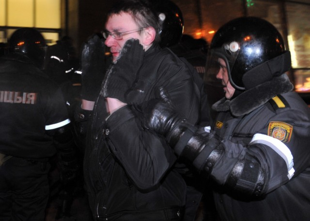 A group of people is surrounded by riot police during an opposition rally in Minsk early on December 20, 2010. Belarus police arrested hundreds of protestors as they used force to break up a mass demonstration against the expected re-election of President Alexander Lukashenko in disputed polls on Sunday. AFP PHOTO/ VIKTOR DRACHEV , Riot policemen arrest a man during an opposition rally in Minsk early on December 20, 2010. Belarus police arrested hundreds of protestors as they used force to break up a mass demonstration against the expected re-election of President Alexander Lukashenko in disputed polls on Sunday. AFP PHOTO/ VIKTOR DRACHEV , A protester is arrrested by riot police during an opposition rally in Minsk early on December 20, 2010. Belarus police arrested hundreds of protestors as they used force to break up a mass demonstration against the expected re-election of President Alexander Lukashenko in disputed polls on Sunday. AFP PHOTO/ VIKTOR DRACHEV