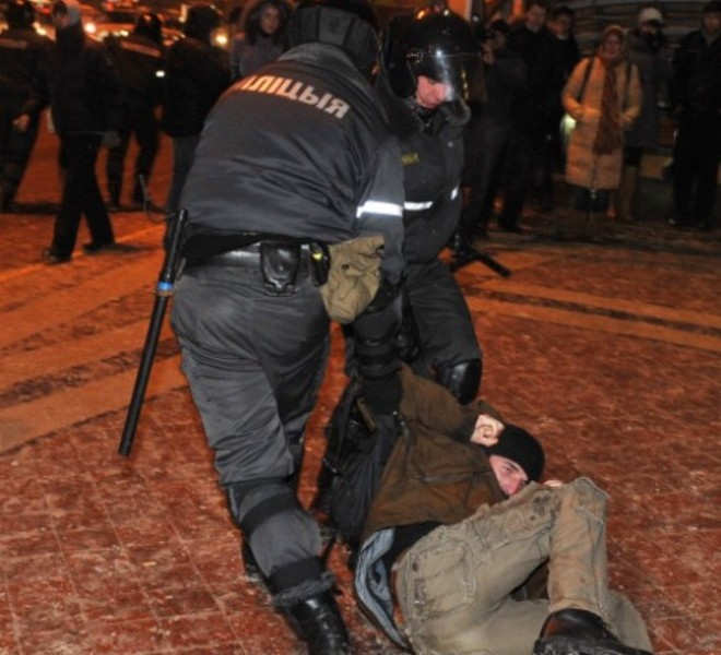 A group of people is surrounded by riot police during an opposition rally in Minsk early on December 20, 2010. Belarus police arrested hundreds of protestors as they used force to break up a mass demonstration against the expected re-election of President Alexander Lukashenko in disputed polls on Sunday. AFP PHOTO/ VIKTOR DRACHEV , Riot policemen arrest a man during an opposition rally in Minsk early on December 20, 2010. Belarus police arrested hundreds of protestors as they used force to break up a mass demonstration against the expected re-election of President Alexander Lukashenko in disputed polls on Sunday. AFP PHOTO/ VIKTOR DRACHEV