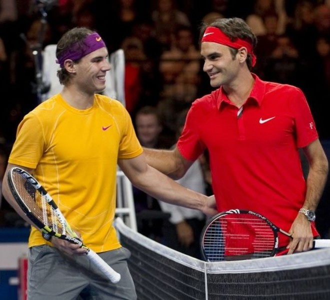 "Spain's Rafael Nadal (L) poses with Switzerland's Roger Federer prior to their charity game on December 21, 2010 in Zurich. ""The Match for Africa"" was organized to raises money for the Roger Federer Foundation which supports sporting activities for underprivileged children in Africa and in Switzerland.   AFP PHOTO / FABRICE COFFRINI"