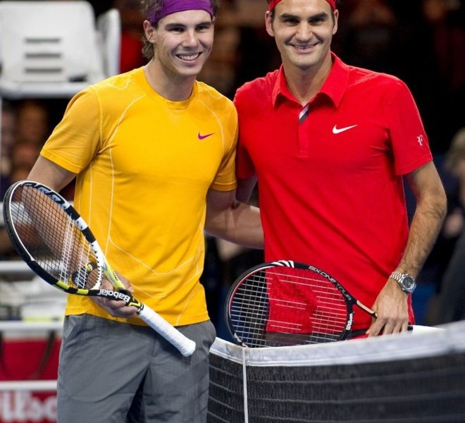 "Spain's Rafael Nadal (L) poses with Switzerland's Roger Federer prior to their charity game on December 21, 2010 in Zurich. ""The Match for Africa"" was organized to raise money for the Roger Federer Foundation which supports sporting activities for underprivileged children in Africa and in Switzerland.   AFP PHOTO / FABRICE COFFRINI"