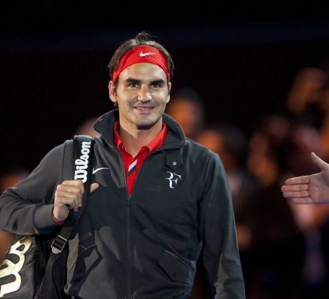 "Switzerland's Roger Federer looks on as he arrives to play against Spain's Rafael Nadal during a charity game on December 21, 2010 in Zurich. ""The Match for Africa"" was organized to raise money for the Roger Federer Foundation which supports sporting activities for underprivileged children in Africa and in Switzerland.   AFP PHOTO / FABRICE COFFRINI"