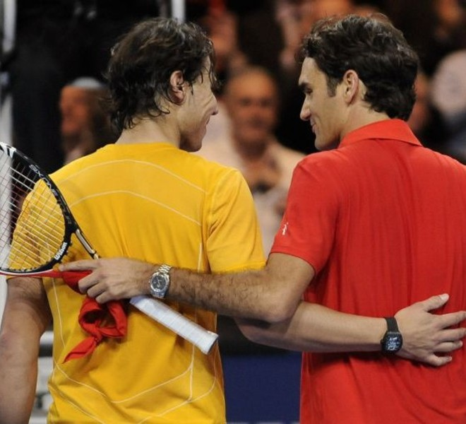 "Spain's Rafael Nadal (L) speaks with Switzerland's Roger Federer after their charity tennis game on December 21, 2010 in Zurich. ""The Match for Africa"" is organized to raise money for the Roger Federer Foundation which supports sporting activities for underprivileged children in Africa and in Switzerland. AFP PHOTO / FABRICE COFFRINI"