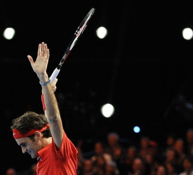 "Switzerland's Roger Federer reacts after he won against Spain's Rafael Nadal during a charity tennis game on December 21, 2010 in Zurich. ""The Match for Africa"" is organized to raise money for the Roger Federer Foundation which supports sporting activities for underprivileged children in Africa and in Switzerland. AFP PHOTO / FABRICE COFFRINI"