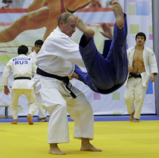 "Russia's Prime Minister Vladimir Putin (foreground) takes part in a judo training session at the ""Moscow"" sports complex in St. Petersburg, on December 22, 2010.   AFP PHOTO/ RIA-NOVOSTI POOL/ ALEXEY DRUZHININ"