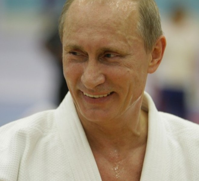 "Russia's Prime Minister Vladimir Putin smiles as he takes part in a judo training session at the ""Moscow"" sports complex in St. Petersburg, on December 22, 2010.   AFP PHOTO/ RIA-NOVOSTI POOL/ ALEXEY DRUZHININ"